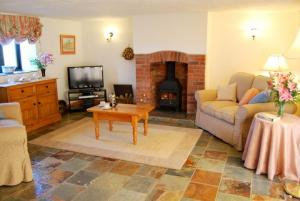 The lounge of Clematis Cottage, at Downe Cottages, Hartland, North Devon
