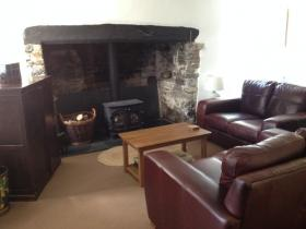 The lounge at East Titchberry Farm Cottage, Hartland - cosy self catering