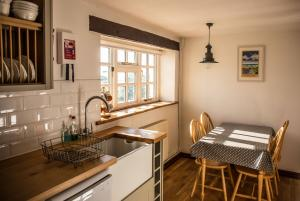 The Milking Parlour kitchen at Cheristow Farm Cottages luxury self catering