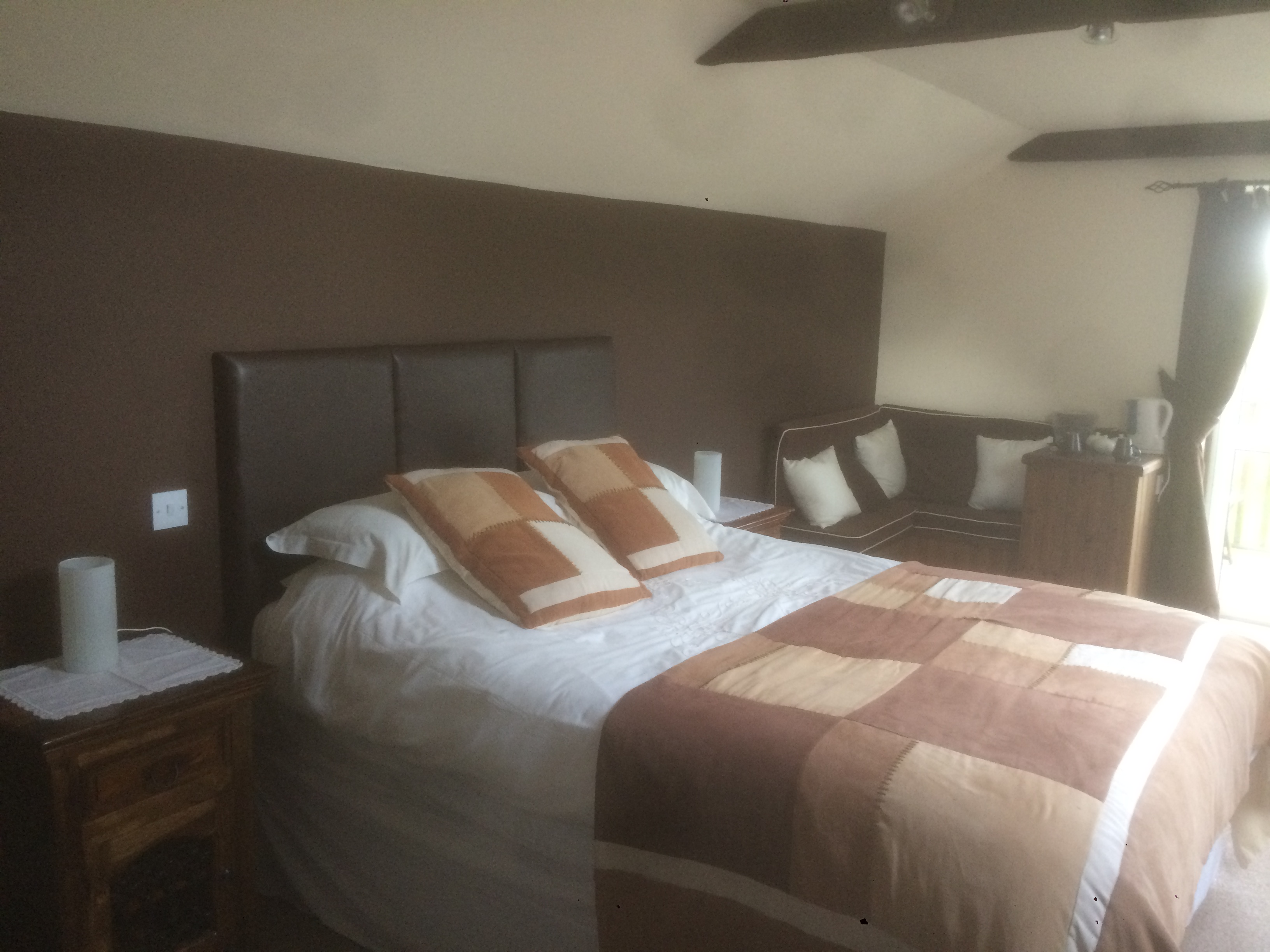 The bedroom at The Granary, combining the atmosphere of a farmhouse B&B with the privacy and luxury of a separate suite, B&B in Hartland, North Devon