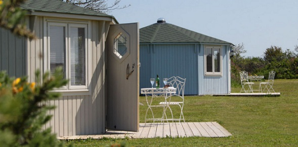 Coastal Cabins - the finest glamping in luxurious, wooden cabins set generously on a 3 acre lakeside site