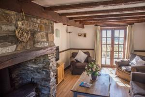 The Milking Parlour sitting room at Cheristow Farm Cottages luxury self catering