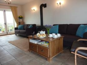 The sitting with log burner in the lounge at the Byre, Hartland, North Devon