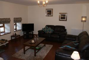 The lounge at Great Philham House Holiday Cottage, Hartland, North Devon