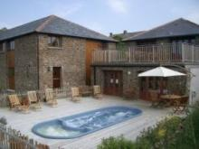 Jeremy Fisher Cottage and the summer Swim Spa at 5 star Long Furlong Cottages